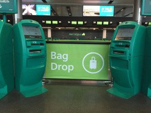 Q-Banner Custom Stanchion Signs Bag Drop in an Airport